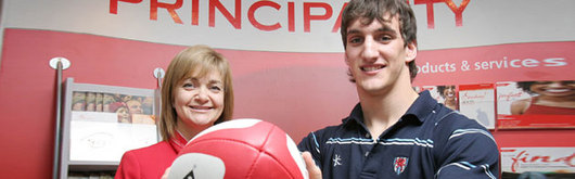 Sam Warburton with Angela Hellier of Principality Building Society in Whitchurch; the Principality Premiership Player of the Month