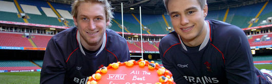 Robinson and Czekaj celebrate 50 caps with a special commemorative cake