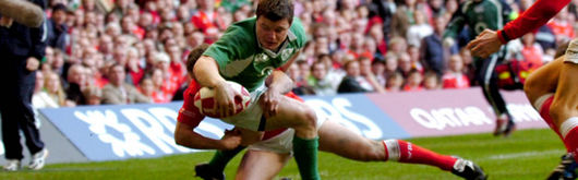 Brian O'Driscoll scores Ireland's second as Kevin Morgan attempts to make the tackle