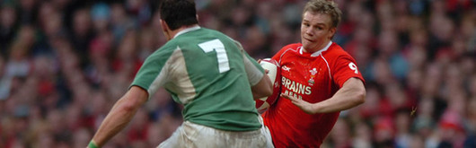 Dwayne Peel, evading Ireland's David Wallace in the 2007 RBS Six Nations, returns to Magners League action this Friday