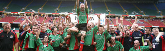 Llandovery, led by Captain Arwel Davies, celebrate their Konica MInolta Cup final win at the Millennium Stadium