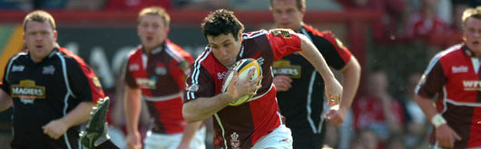 Wales Captain Stephen Jones began the Scarlet try scoring rout at Stradey Park over Edinburgh