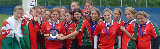 East Wales girls U14 celebrate winning the plate trophy at the National Regional Youth competition