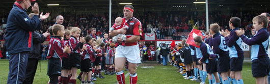 John Davies is given the emotional send off of a guard of honour as he leads the Scarlets out on his final appearance
