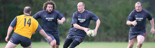 Ceri Jones, far left, attempts to mark Adam Jones and Gareth Thomas in Wales training as Iestyn Thomas looks on