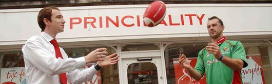 Eirian Davies, Assistant Manager of Principality Building Society in Carmarthen with Principality Player of the Month Arwel Davies, who is captain at Llandovery RFC
