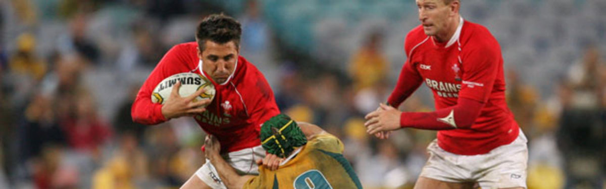 Matt Giteau tackles Gavin Henson in Wales's first-Test loss to Australia in Sydney