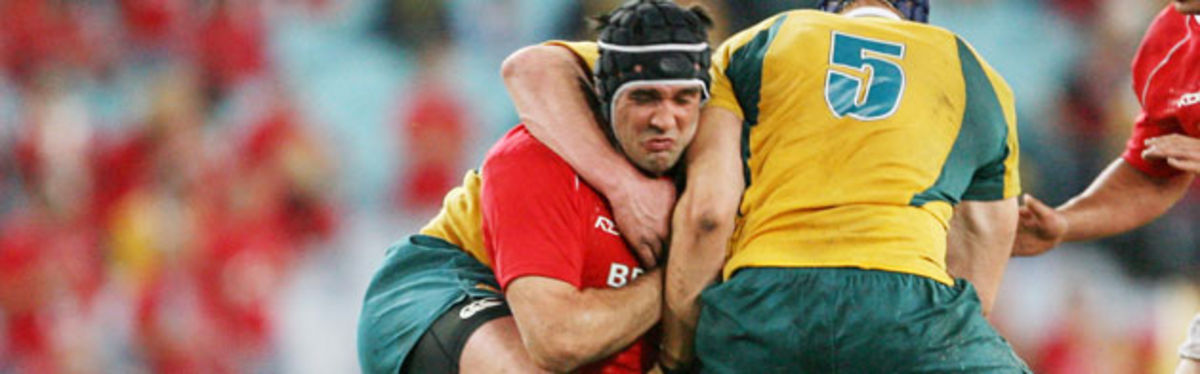 Jonathan Thomas is tackled by Australia's Guy Sheperdson and Mark Chisolm