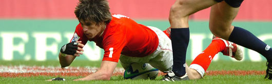 Wales Sevens' Rhodri McAtee scores a try against Scotland Sevens in last season's IRB Sevens World Series