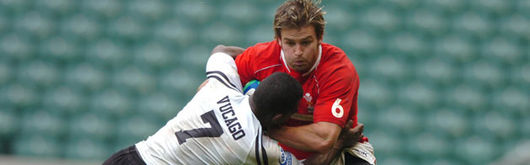 Wales's Tal Selley is tackled by Fiji's Emosi Vucago in last season's London Sevens leg at Twickenham