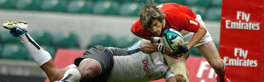 Rhodri McAtee is held by the Fijian defence last Sunday