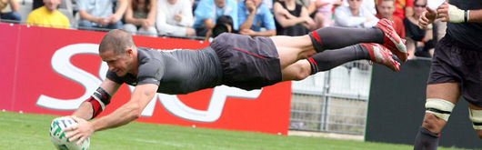 Shane Williams dives over for a try against Canada in the Rugby World Cup