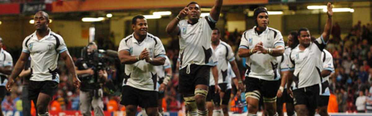 The Fijians celebrate their pool B victory over Canada at the Millennium Stadium