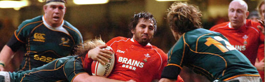Gavin Henson feels the force of the South Africa defence in the Prince William Cup clash at the Millennium Stadium in November 2007