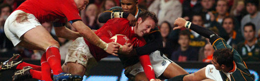 Morgan Stoddart, making his try-scoring debut in the inaugural Prince William Cup match in November 2007, is tackled by JP Pietersen and Ruan Pienaar