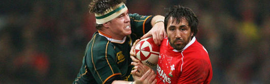 John Smit tackles Gavin Henson in the November 2007 Prince William Cup clash at the Millennium Stadium