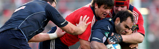 Deacon Manu is tackled by Munster's Donncha O'Callaghan in this season's Heineken Cup