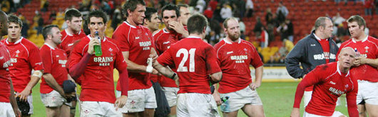 A dejected Wales team mull over two Test defeats