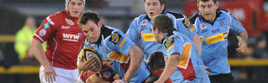 Joe Bearman takes on the Scarlets defence in the regional derby at Rodney Parade