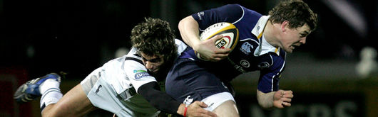 Ospreys' Gareth Owen tackles Leinster's captain Brian O'Driscoll