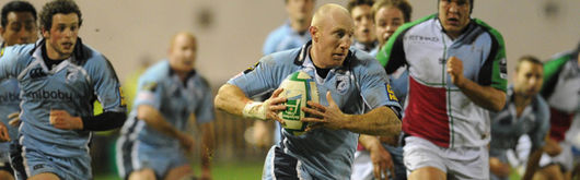 Blues try-scorer Tom Shanklin leads a charge against Harlequins