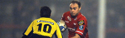 Llanelli Scarlets' Ceiron Thomas takes on Clermont Auvergne's Brock James