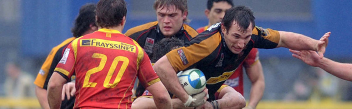 Joe Bearman tries to break through the Perpignan defence for the Dragons