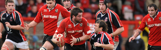 Pontypridd captain Nathan Strong leads a charge against Llanelli