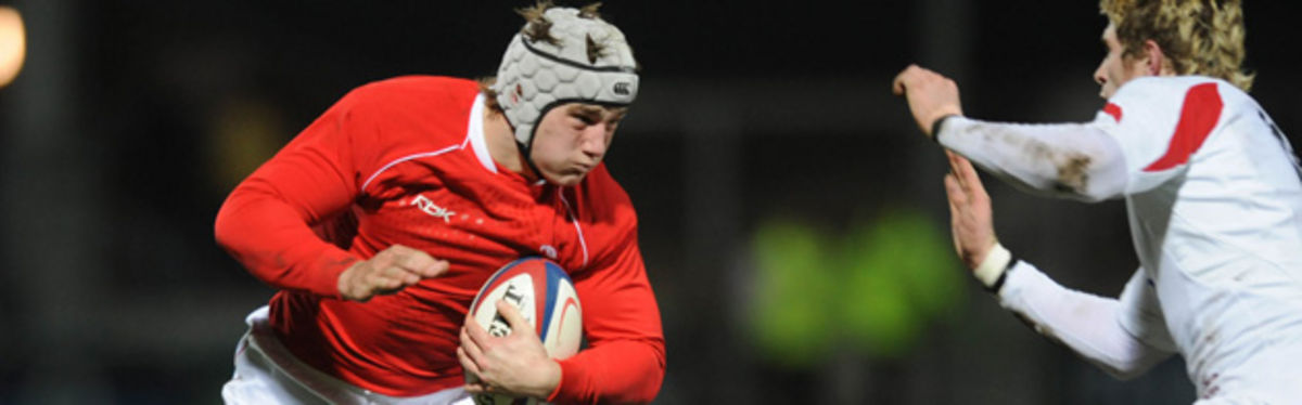 Wales U20 centre Jonathan Davies takes on the England U20 defence at Kingsholm