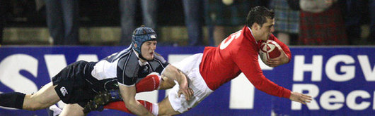 Daniel Evans beats Tom Bury as he dives in for a try against Scotland U20