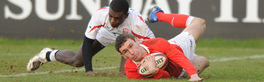 James Loxton grounds the ball for a try against England U20