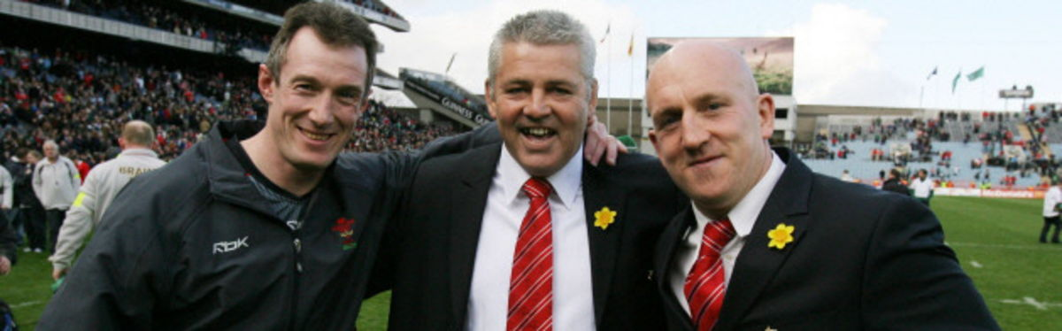 Wales Head Coach Warren Gatland, with assistants Rob Howley and Shaun Edwards, celebrate the Triple Crown victory over Ireland