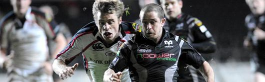 Shane Williams evades new Ospreys' signing Tommy Bowe during a Magners League clash in March
