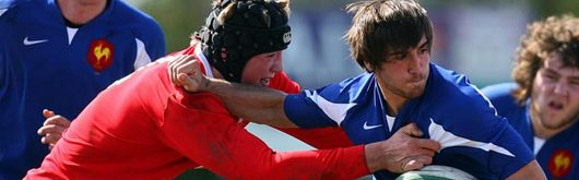 Wales's Lloyd Peers tackles Julien Cabannes of France U18 in the Welsh victory in Cork