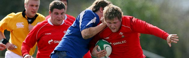 Wales U18 captain Rhys Williams is tackled by the France U18 defence