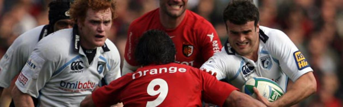 Jamie Roberts and Paul Tito take on Toulouse scrum half Byron Kelleher