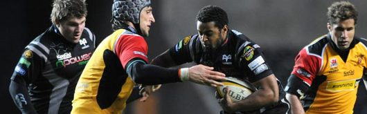 Ospreys try-scorer Aled Brew is tackled by Dragons' Luke Charteris in the Magners League clash at the Liberty Stadium
