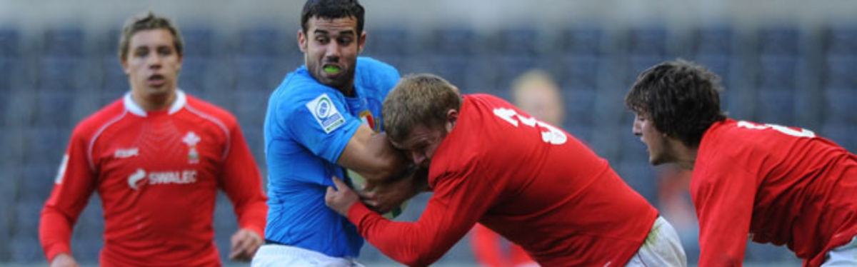 Wales U20 prop Scott Andrews tackles Italian try-scorer Andrea Bacchetti in the clash at the Liberty Stadium