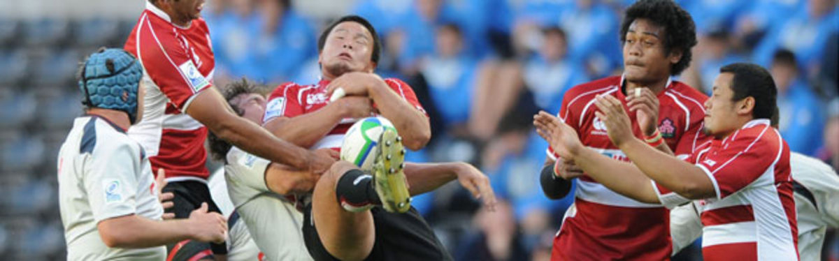 Japan's Ryuhei Arita is tackled by Wales captain Sam Warburton in the Pool D clash