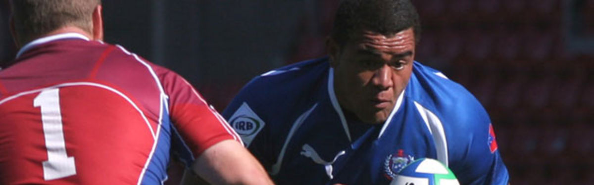 Samoa's Anetelea Lalotoa takes on th USA's Stevie Johnston