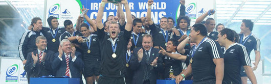 New Zealand U20 captain Chris Smith lifts the IRB Junior World Championship trophy in front of his triumphant teammates