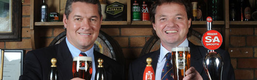 WRU Chairman David Pickering and Sales and Marketing Director at Brains, Richard Davies, toast the new sponsorship deal