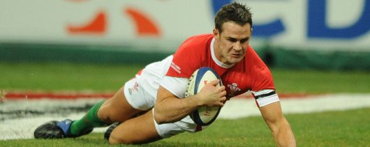 Lee Byrne bursts through the French defence to score for Wales.