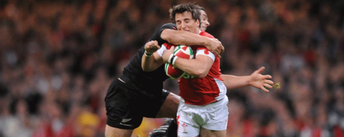 Martin Roberts is tackled by Dan Carter