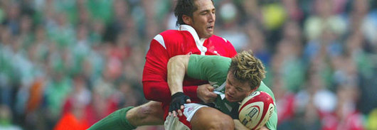 Gavin Henson tackles Brian O'Driscoll last season, but the ban could see him sidelined for this season's Ireland match