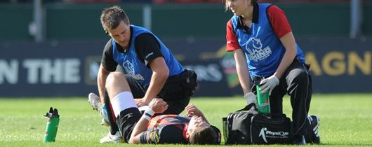 Jason Tovey lies injured