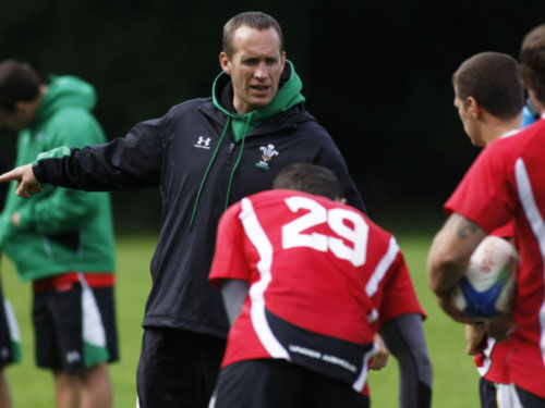 Richard Hodges trains Wales Sevens during the 2010 Commonwealth Games