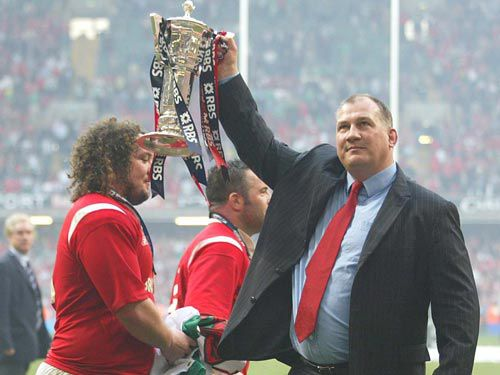 Mike Ruddock celebrates the delivery of Wales's first Grand Slam in 27 years back in 2005