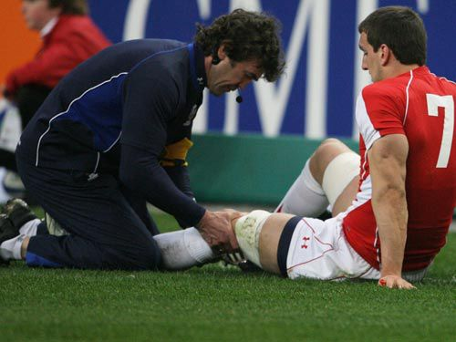Mark Davies attends to Sam Warburton during Wales's clash with France in the 2011 RBS 6 Nations