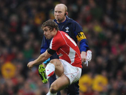 Neil Jenkins observes Leigh Halfpenny take a place kick during an international match
